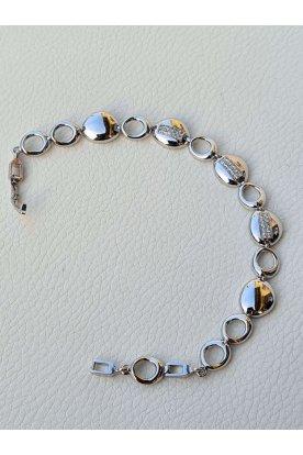 Elegáns női ezüst színű karkötő kövekkel