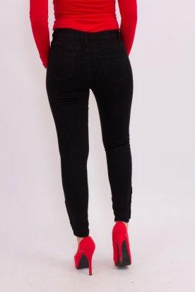 Divatos fekete alján gombokkal díszített női nadrág