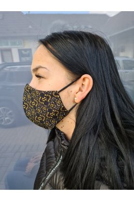Divatos fekete alapon egyedi mintával ellátott maszk